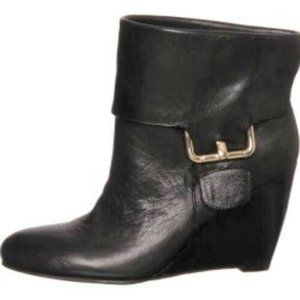 As new- Black leather wedge bootie